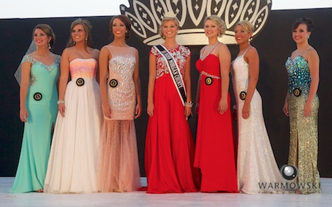 Queen contestants in evening wear.