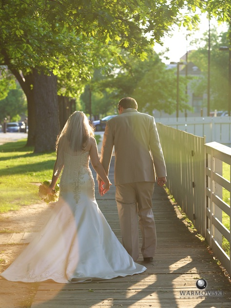 Laura & Josh walk into the setting sun and head to reception.