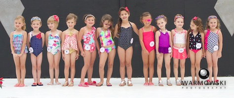 Princess contestants in swimsuits.