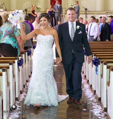 Adria and Jeremy walk down the aisle after their wedding at MacMurray College's Annie Merner Chapel. Wedding photography by Steve & Tiffany Warmowski.