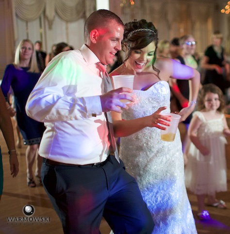 Dancing into the night at Hamilton's 110 North East. Wedding photography by Steve & Tiffany Warmowski.