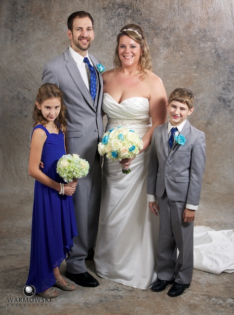 Lizzie & Brandon had family portraits at our studio before their wedding reception at The Elks. Wedding photography by Steve of Warmowski Photography.