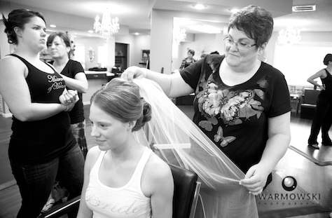 Amanda's mom adjusts veil, at A Hair Company beauty salon in Jacksonville, Illinois. Photo by Steve & Tiffany of Warmowski Photography.