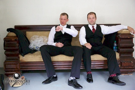 Ryan and his groomsmen are ready and waiting. Wedding photography by Steve & Tiffany Warmowski