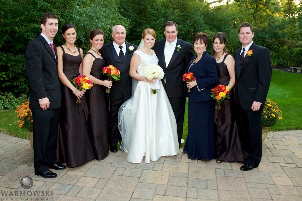 Family photo during the wedding of Elizabeth's sister, Meghan, in 2008. Portraits also in back yard and wedding reception at Crystal Tree Golf and Country Club in Orland Park. Megan has her wedding at St. Michael's Church, Orland Park (the church was under renovation so Elizabeth chose St. Rita of Cascia Shrine Chapel in Chicago for her ceremony.) Wedding photography by Tiffany & Steve Warmowski.