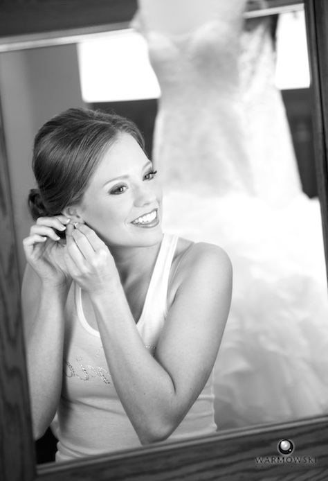Amanda getting ready to put on dress, Jacksonville Country Club. Photo by Steve & Tiffany of Warmowski Photography.