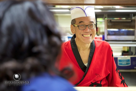 Hiro working the counter, Happy Sushi in Springfield. Wedding photography by Steve of Warmowski Photography.