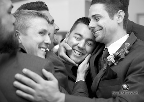 Nick gets a group hug from groomsmen, wedding at the Jacksonville Country Club. Photo by Steve & Tiffany of Warmowski Photography.