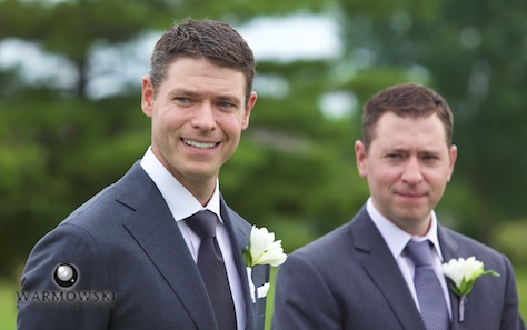 Daniel with his best man (and twin Brother), outdoor wedding ceremony at Geneva National Golf Club, July 2015 in Lake Geneva, Wisconsin. Wedding photography by Steve & Tiffany Warmowski