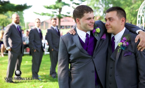 Best Man Clay gives Groom Nick a hug as they wait for the start of the outdoor wedding ceremony at the Jacksonville Country Club. Photo by Steve & Tiffany of Warmowski Photography.