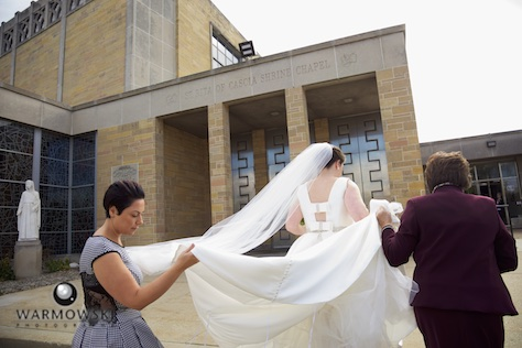 Elizabeth arrives at St. Rita of Cascia Shrine Chapel in Chicago for ceremony. Accompanied by her mother and wedding planner. Wedding photography by Tiffany & Steve & Warmowski.