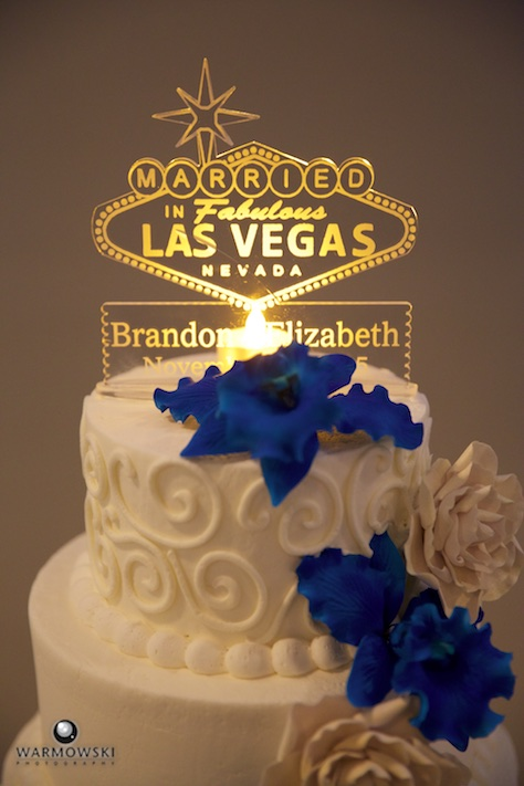 Lizzie & Brandon's wedding reception at The Elks lodge in Jacksonville. Their cake had a Las Vegas sign, to recognize their wedding ceremony earlier in the year. Wedding photography by Steve of Warmowski Photography.