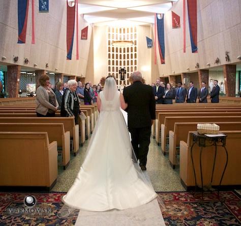 Elizabeth walks down the aisle with her father, St. Rita of Cascia Shrine Chapel in Chicago. Wedding photography by Tiffany & Steve & Warmowski.