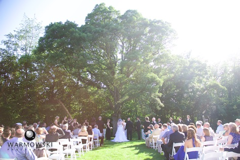 The wedding ceremony site was beneath the shade of a massive oak tree Ñ perfect way to beat the June heat. Wedding photography by Tiffany & Steve of Warmowski Photography.