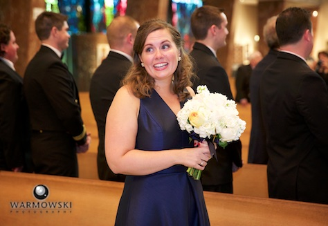 Daniel's sister watches Daniel's reaction as he sees his bride for the first time on their wedding day. Ceremony at St. Rita of Cascia Shrine Chapel in Chicago. Wedding photography by Tiffany & Steve & Warmowski.