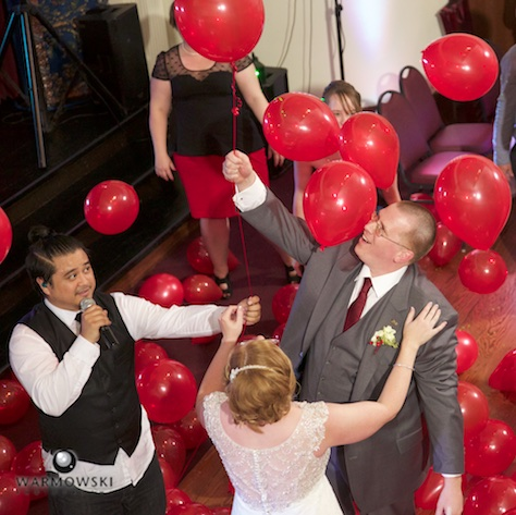 As a special treat, when Fun DMC played a mashup of Nena's 99 Luftballons, the dance floor was filled with red balloons. Amy & Ryan's wedding reception at the Hoogland Center for the Arts in Springfield. Wedding photography by Tiffany & Steve of Warmowski Photography.