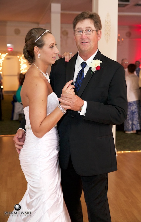 Amber starts her first dance with her father, Bill. Wedding photography by Steve & Tiffany Warmowski