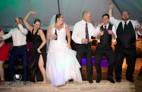 As the rain poured, the party fueled by Music Source Professional Disc Jockey Service went on in the party tent next to the house. Wedding photography by Tiffany & Steve of Warmowski Photography.