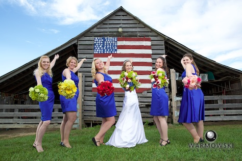 Kelly and her bridesmaids take advantage of a popular portrait spot at Buena Vista Farms. Wedding photography by Steve & Tiffany Warmowski