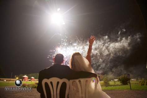 Mindi & Doug watch fireworks outside the tent on their wedding night at Buena Vista Farms. Photo by Tiffany & Steve Warmowski