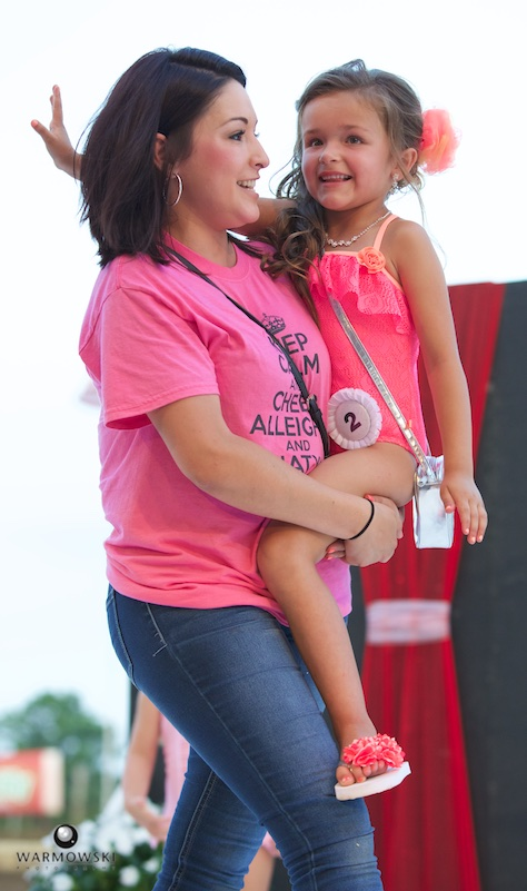 Princess contestant Alleigha King gets a boost from mom Melissa Flores during bathing suit portion of contest.
