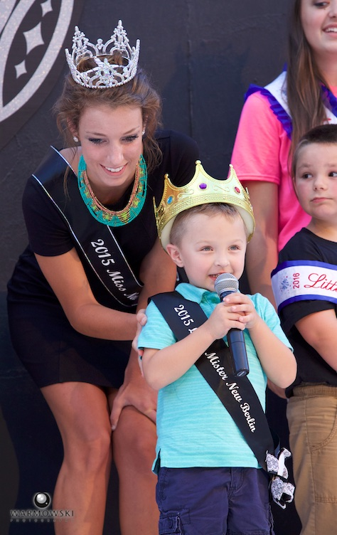 Little Mister New Berlin gets control of microphone during well wishes from visiting royalty.