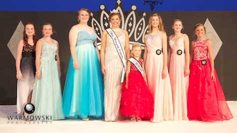 Morgan County Fair Junior Miss contestants in dresses (from left) Camille Brown, Rylie Bettis, Marlee Shucker, (2015 Queen Abby Tomhave/2015 Princess Naveah Benz), Abigayle Lewis, Brooklyn Clayton, and Kaylee Ford.